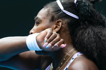 Pretty, bejeweled pastel nails plus playful nail part makes for very fun nail inspiration via Serena Williams.