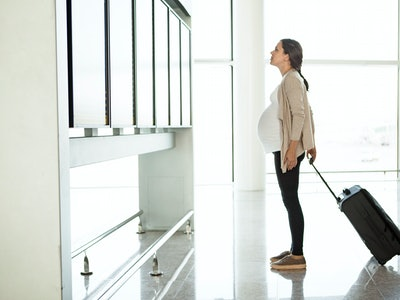 pregnant woman at airport
