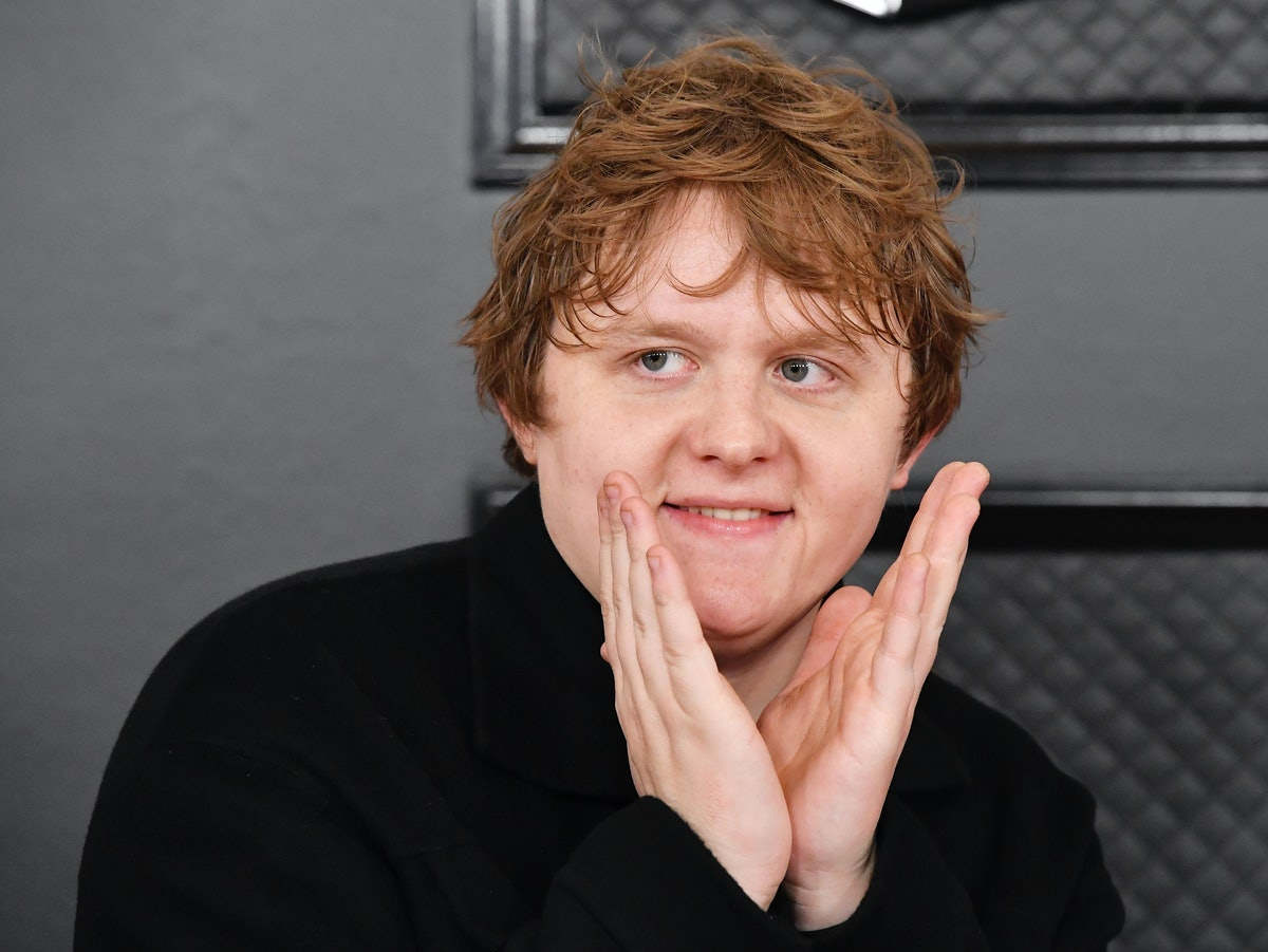 Lewis Capaldi poses on the red carpet at the 62nd annual Grammy Awards.