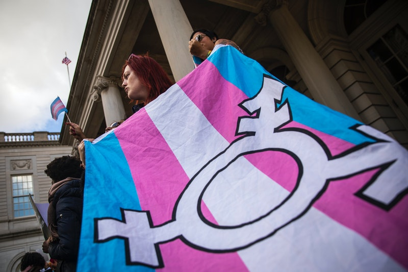 A transgender flag being carried by an activist. Bills denying healthcare to trans youth are based on myths and misinformation.