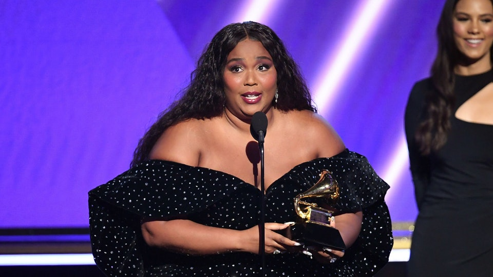 Lizzo won the Grammy for best pop solo performance and John Legend looked super proud.
