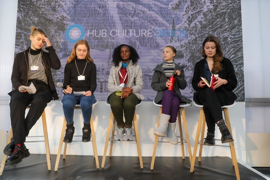 Swedish activist Greta Thunberg and Ugandan activist Vanessa Nakate have called out a news outlet for cropping Nakate out of a photo.