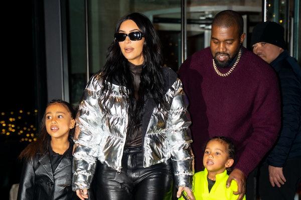 Kim Kardashian, Kanye West, North West, and Saint West step out together.