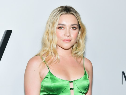 Florence Pugh's updo at the Oscars Nominees Luncheon is a modern twist on the classic red carpet style.