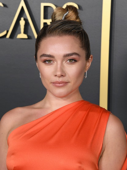 Florence Pugh's updo at the Oscars Nominees Luncheon was ultra-modern, and perfectly complemented her tangerine Monse dress.