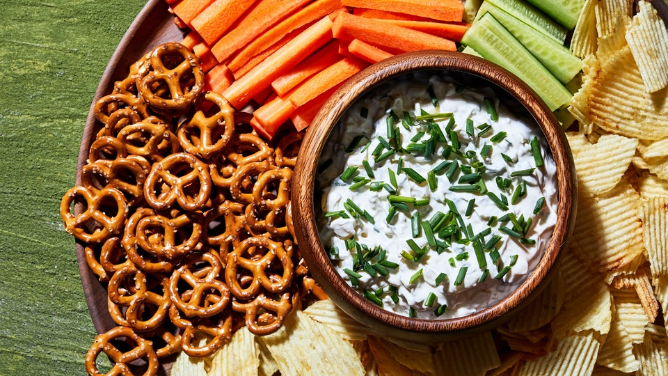 a plate of chips, veggies, pretzels and dip for super bowl from walmart