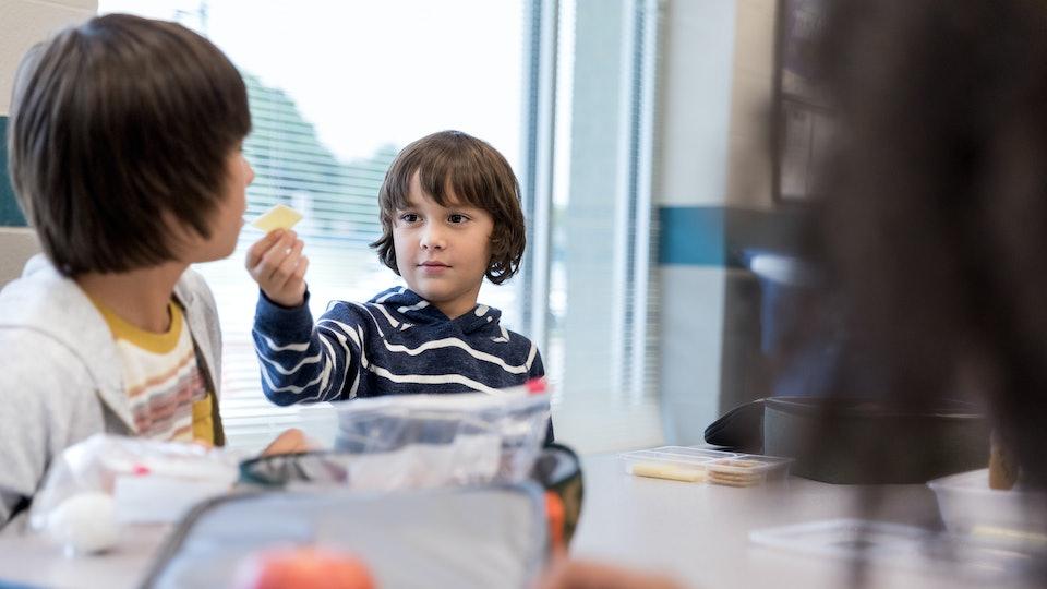kids at school eating snacks