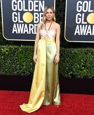 Sienna Miller wore a citrus-hued halterneck Gucci dress to the 2020 Golden Globes
