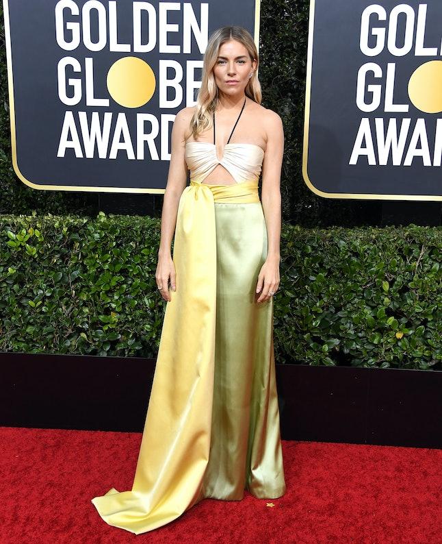 Sienna Miller wore a citrus-hued halterneck Gucci dress to the 2020 Golden Globes