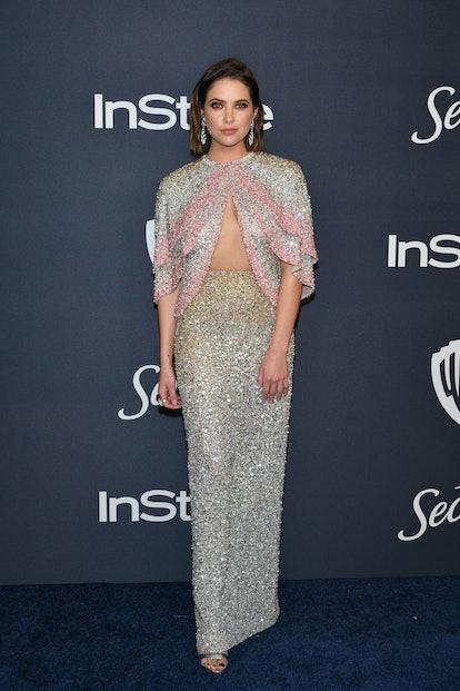 Ashley Benson's Golden Globes dress featured an open cape.