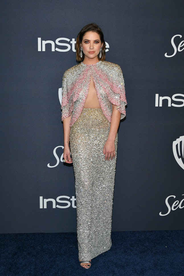 Ashley Benson's Golden Globes dress featured an open cape.