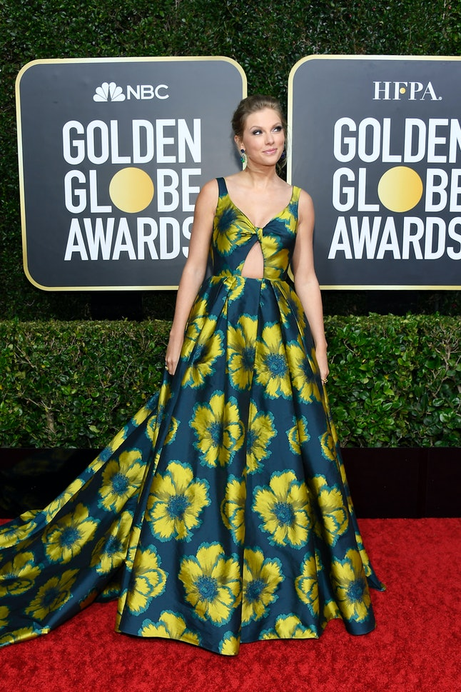 """Taylor Swift's Golden Globes dress was reminiscent of her """"Lover"""" album."""