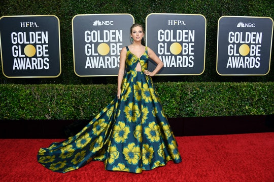 Taylor Swift's bold floral dress stood out on the red carpet at the 2020 Golden Globes.
