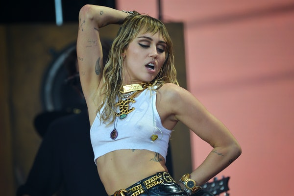 Miley Cyrus rocks out on stage.