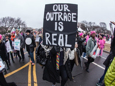 people at a women's march holding signs