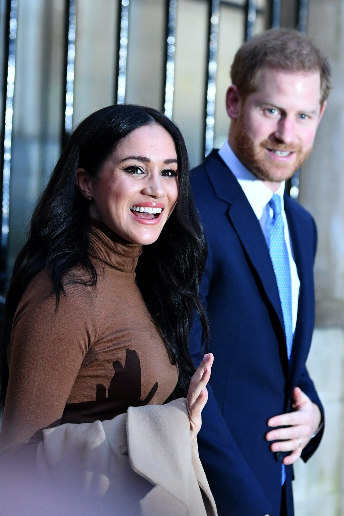 Meghan Markle and Prince Harry wave to fans.