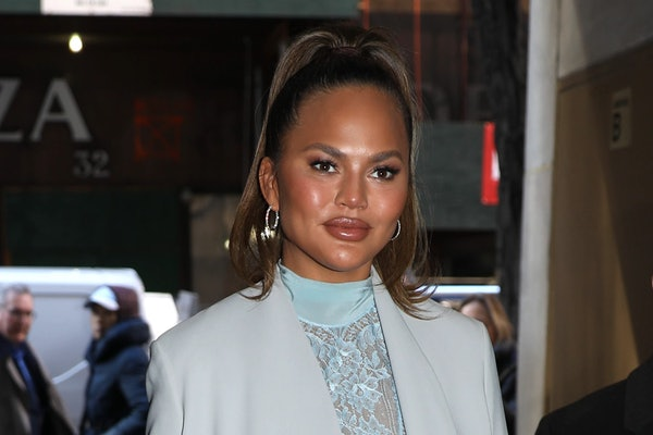 Chrissy Teigen steps out in a trench coat.