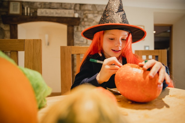 Carving or decorating pumpkins are Halloween activities to do if you're not trick-or-treating.