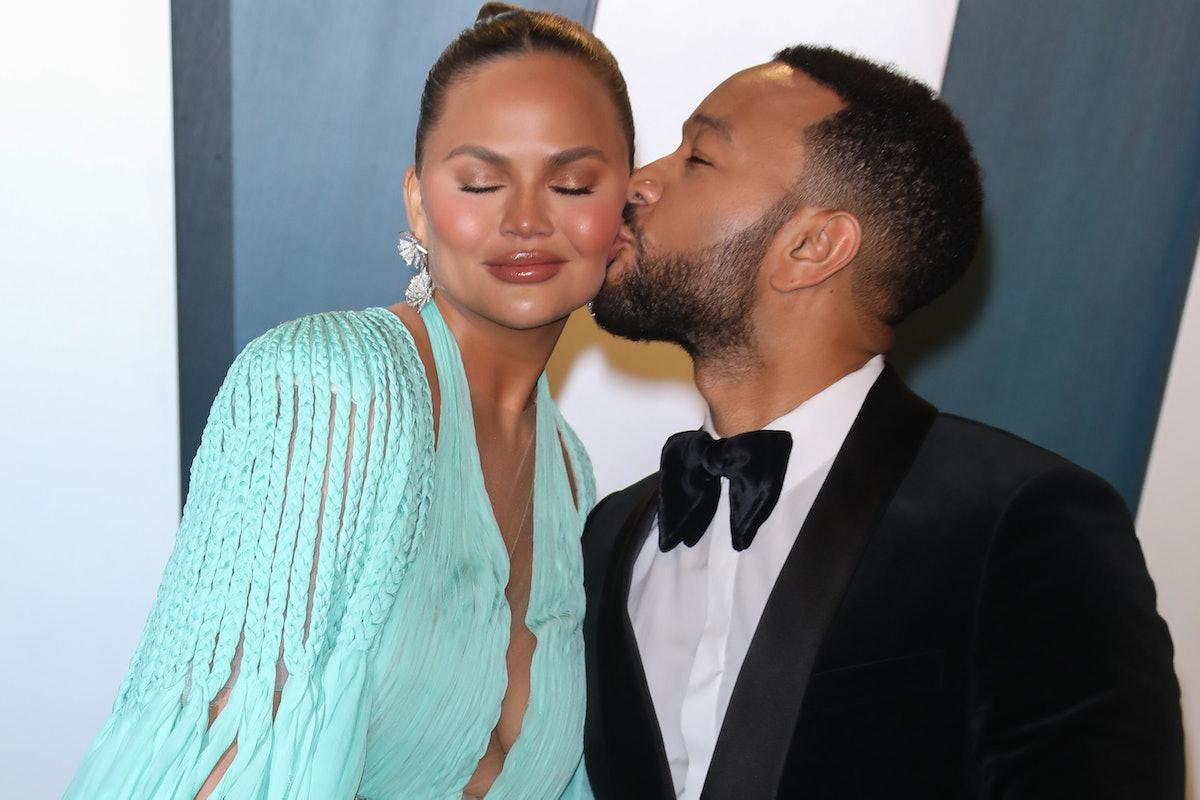 Chrissy Teigen and John Legend attend the Vanity Fair Oscars Party.