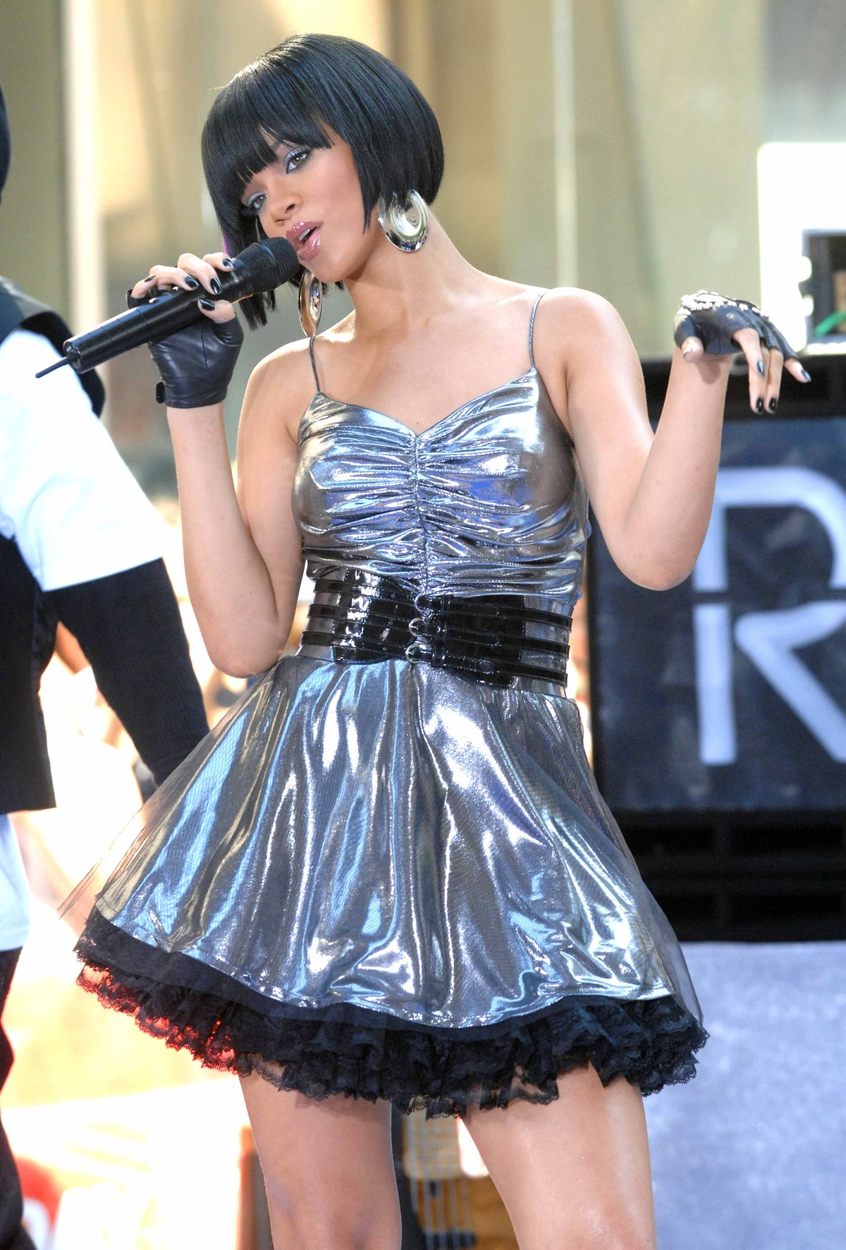 Rihanna hits the stage in a metallic dress.