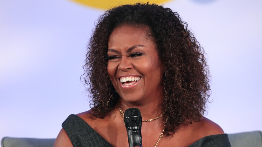 Michelle Obama speaks to a live audience.