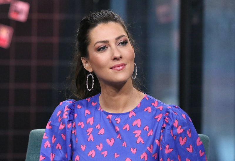 Becca Kufrin fired back at an Instagram commenter who said she broke up with Garrett due to political differences.