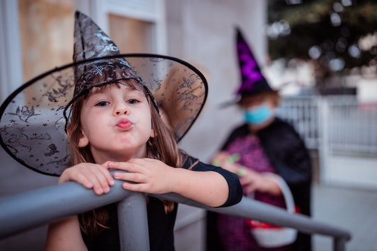 little girl in witch hat
