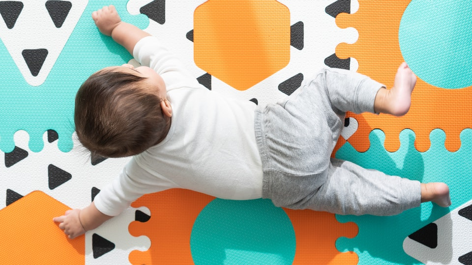If your baby is frustrated during tummy time, experts explain why it's actually normal.