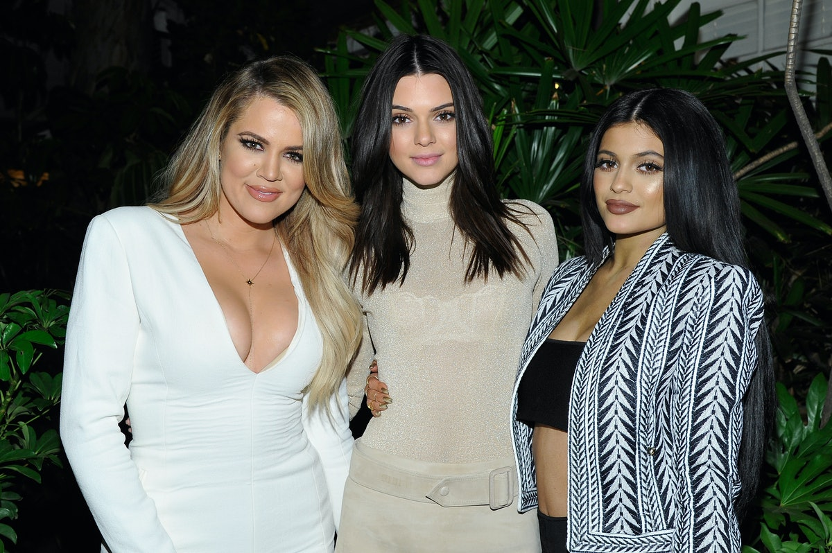 Khloe Kardashian, Kylie Jenner, and Kendall Jenner pose for a photo.