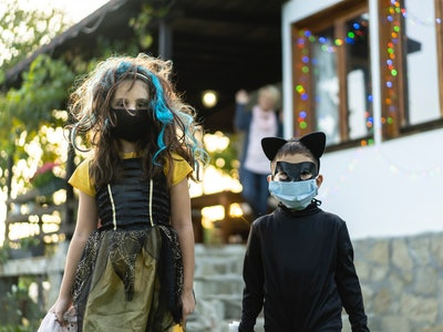 kids going trick or treating in face masks