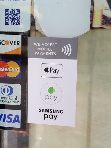 """A photo of a """"we accept mobile payments"""" sticker."""