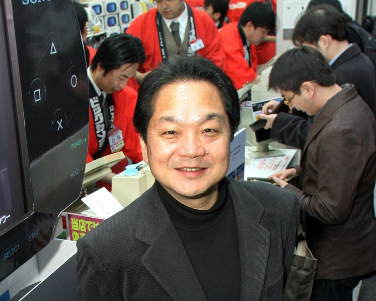 A smiling Ken Kutaragi of PlayStation is seen among other people.