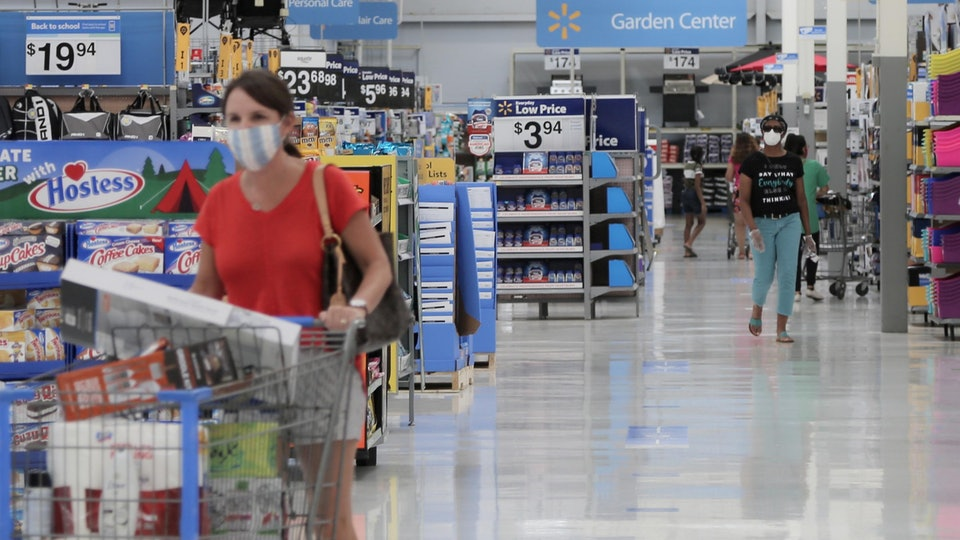 people shopping in face masks at walmart