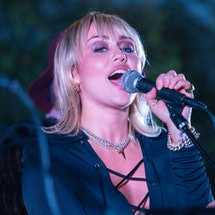 "Miley Cyrus performed an unexpected cover of ""Gimme More"" by Britney Spears for her Backyard Sessions."