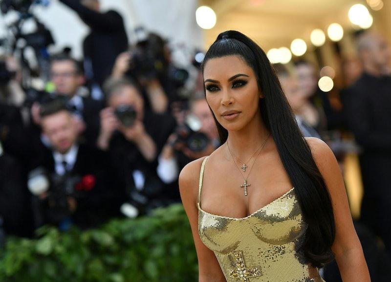 Kim Kardashian's signature beauty look includes smokey eyes and a nude lip