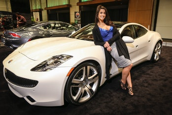 The original Fisker Karma at an unveiling event.