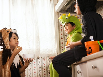 kids eating in kitchen on halloween