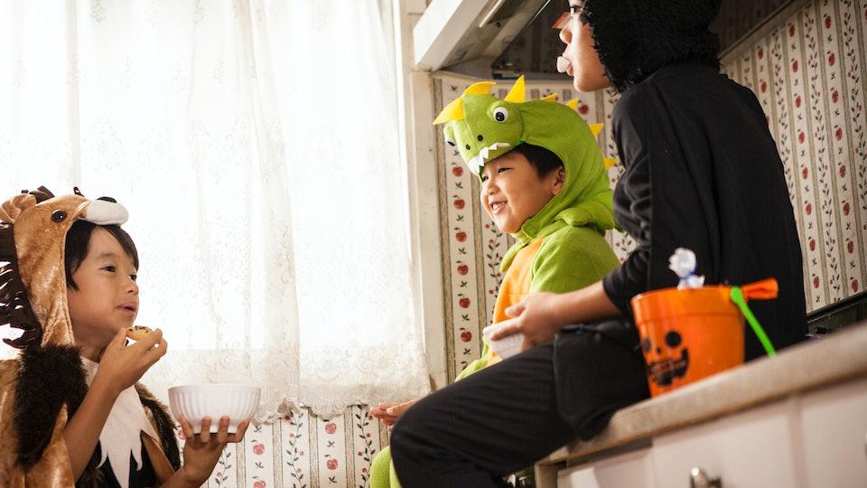 kids eating in kitchen on halloween