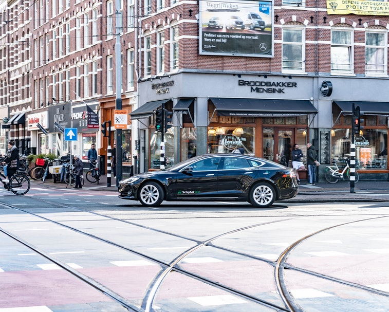 A Tesla Model S is seen turning at an intersection.