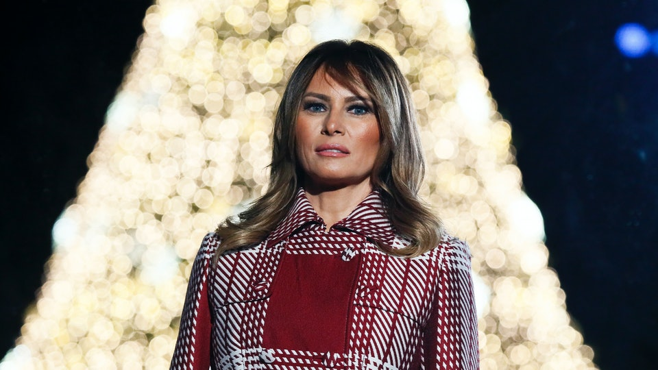 melania trump in front of christmas tree