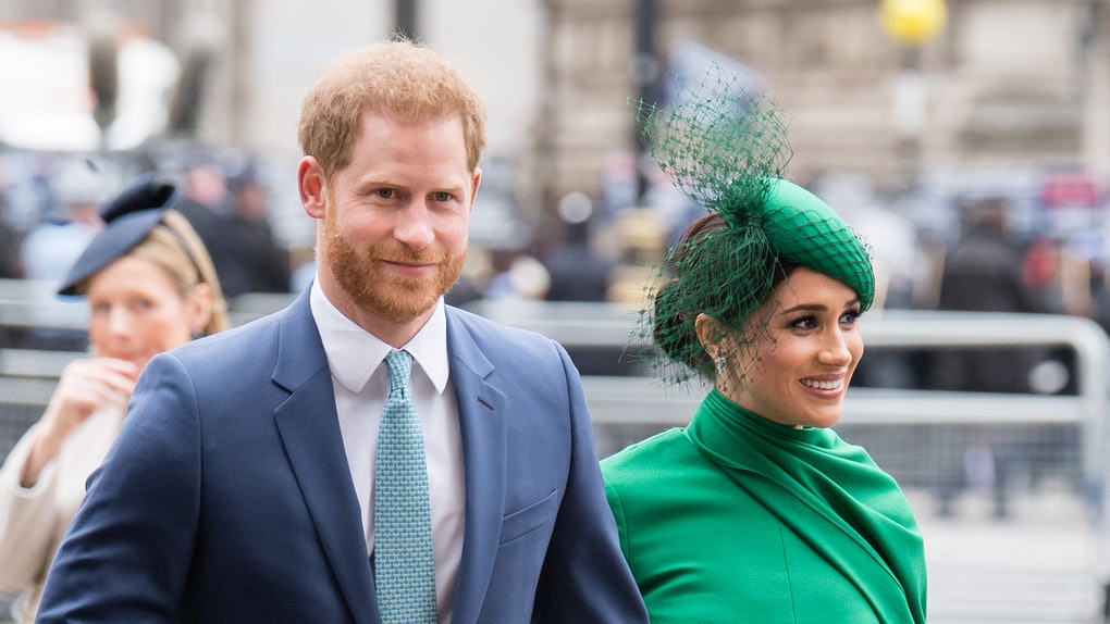 Prince Harry and Meghan Markle hold hands.