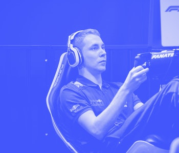 Man playing video games at an e-sports tournament.
