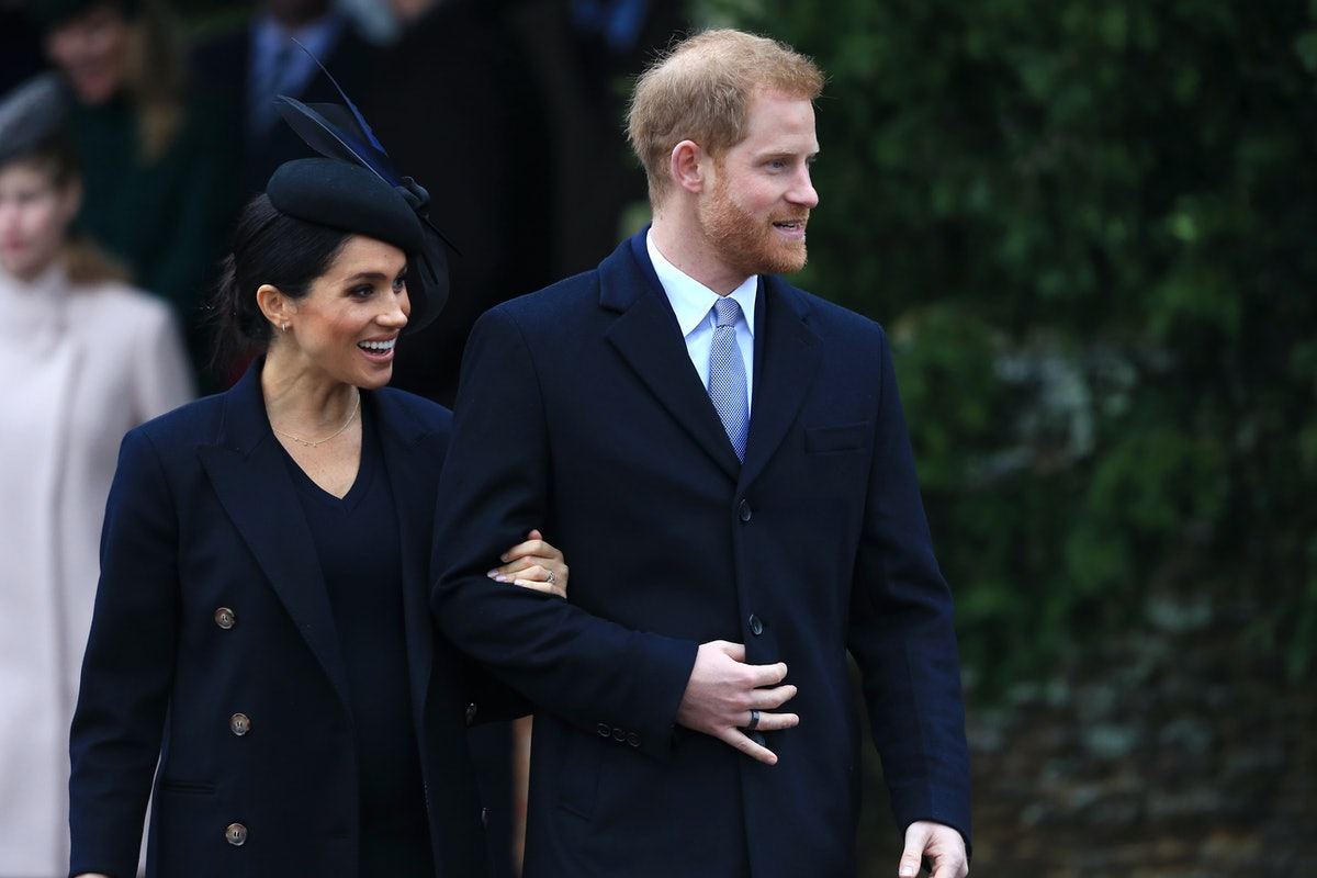 Meghan Markle and Prince Harry step out arm in arm.