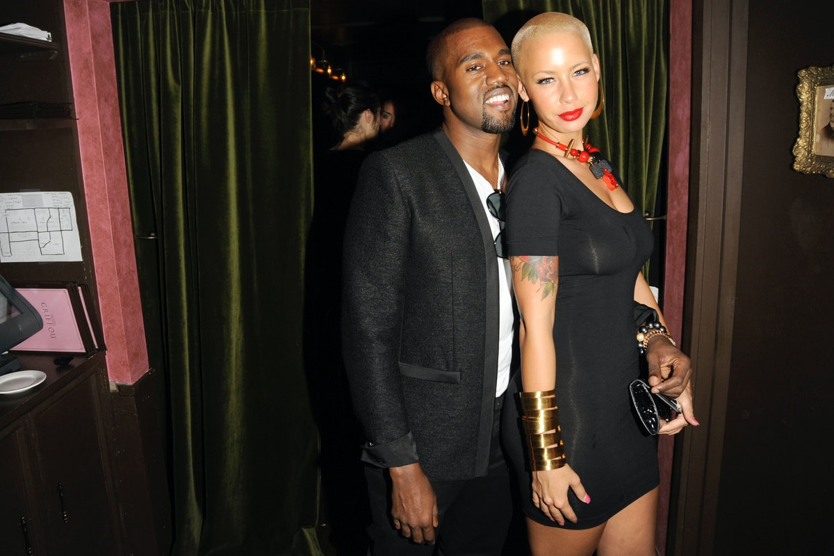 Kanye West and Amber Rose pose for a photo.