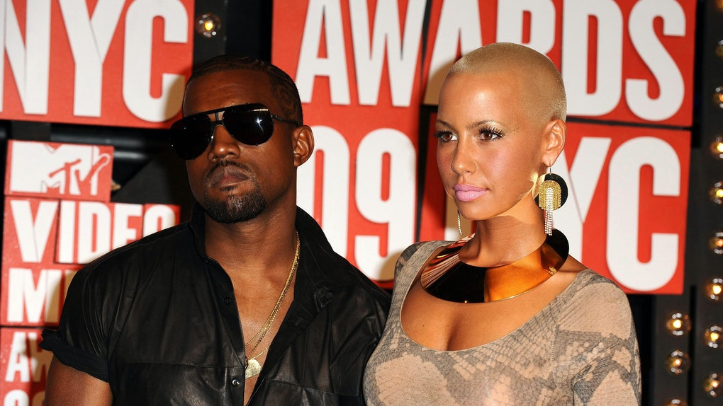 Kanye West and Amber Rose attend the VMAs.