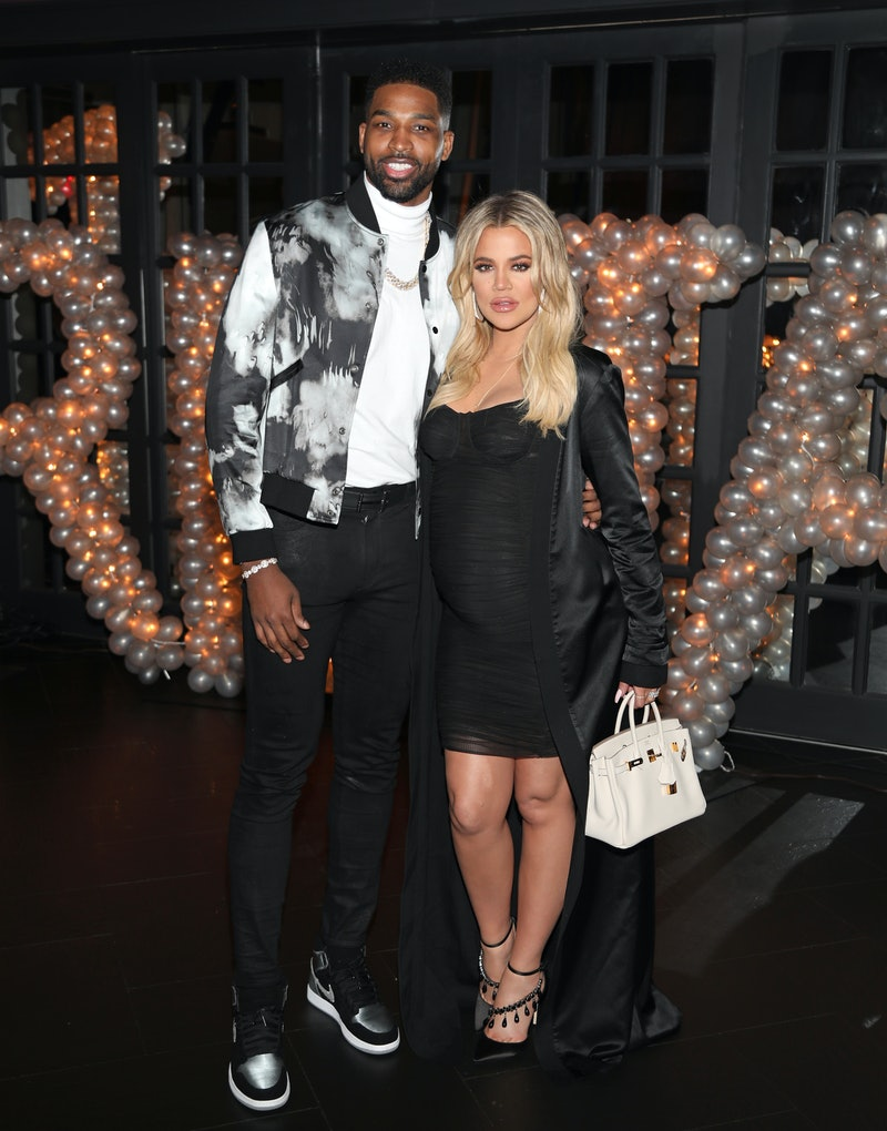 Khloe Kardashian and Tristan Thompson were spotted kissing at Kim Kardashian's 40th birthday party following rumors of a reconciliation.