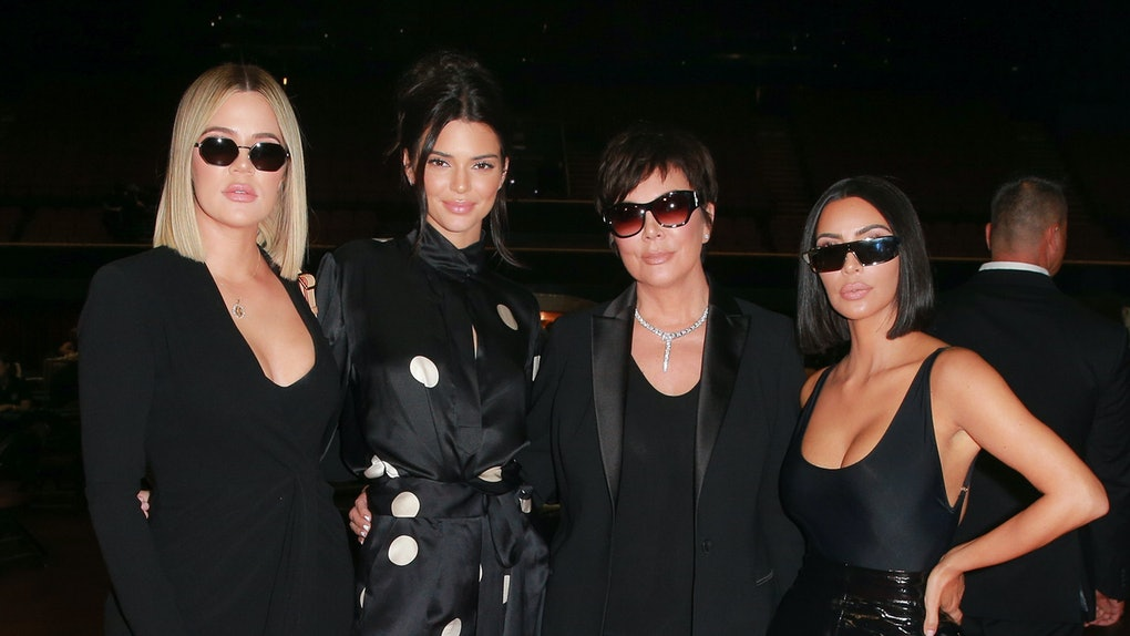 Kris Jenner and her daughters pose for a photo.