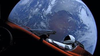 Tesla's Starman dummy is seen in view from space in the red Roadster.