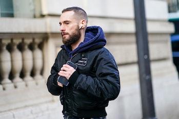 Man wearing Apple's AirPods.