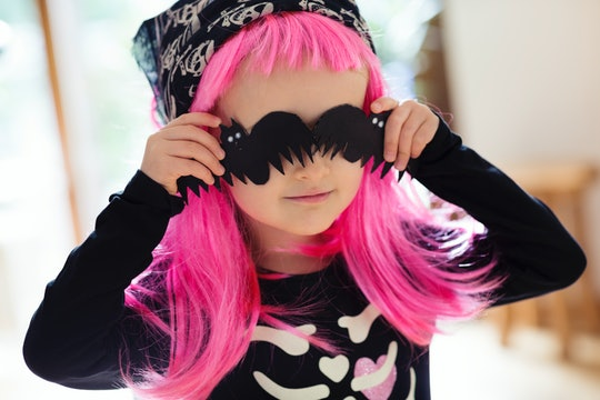 a toddler girl in a pink wig